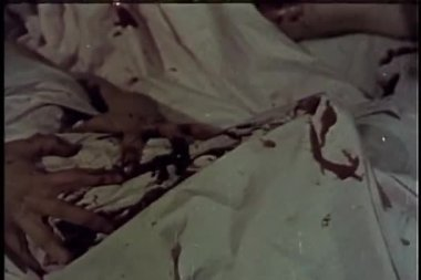 Close-up of axe murder of person in bed — Stock Video