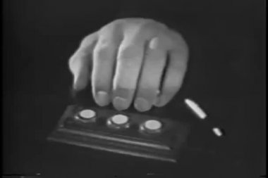 Close-up of shaking hand pushing button — Stock Video