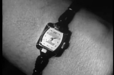 Close-up of woman wearing wristwatch showing 1.37 — Stock Video
