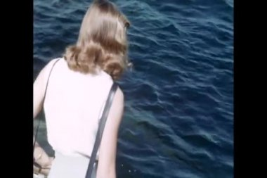 Rear view of woman watching dolphins — Stock Video