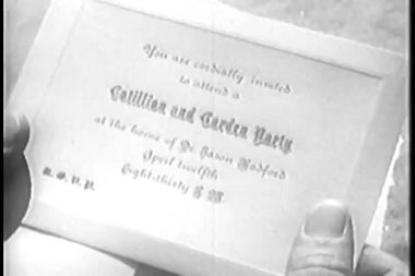 Close-up of person holding invitation card — Vidéo