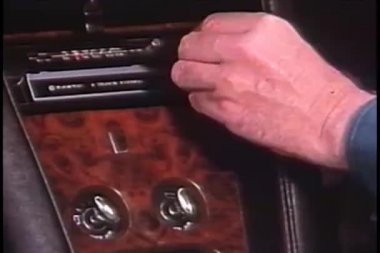 Close-up of hand changing channel on car radio — Stock Video