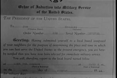 Close-up of 1944 notice of induction into military service — Stock Video