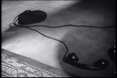 Telephone receiver lying on floor — Stock Video