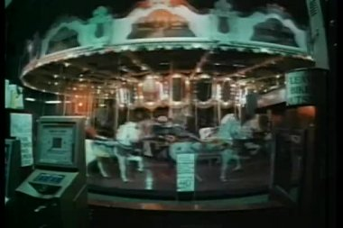 Wide shot of merry-go-round at night — Stock Video