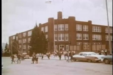 Wide shot of high school students leaving school — Wideo stockowe