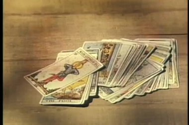 Close-up of male hands picking up deck of tarot cards — Stock Video