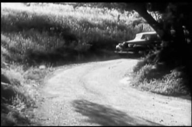 1940s car stopping on side of country road — Stock Video