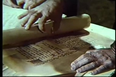 Close-up of hands unrolling scroll — Video Stock