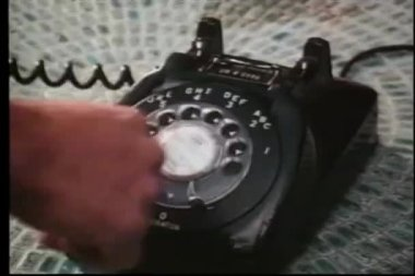 Close-up of a person dialing a rotary phone — Стоковое видео