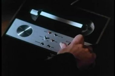 Close-up of person turning on tape recorder — Stock Video