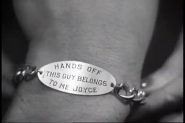 Close-up of woman putting I.D. bracelet on man's wrist — Wideo stockowe