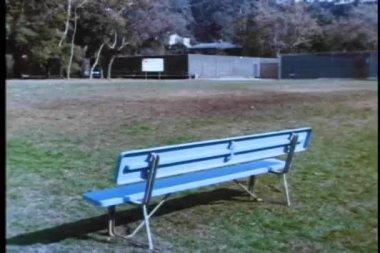 Wide shot of empty bench on baseball field — Stock Video