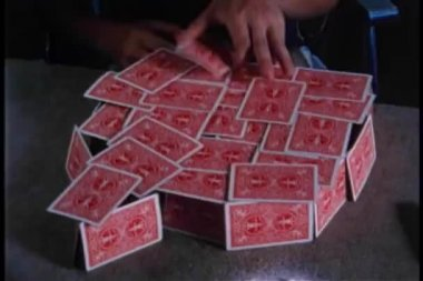 Boy destroying house of cards — Stockvideo