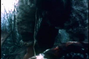 Medium shot of man skinning caribou — 图库视频影像