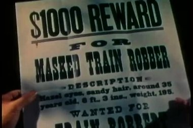Close-up of reward flyer for capture of train robber — Stock Video