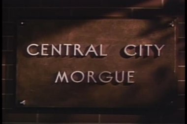 Close-up of Central City Morgue plaque fading into Autopsy Room sign — Stock Video