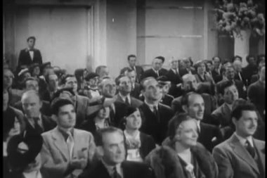 Wide shot of 1930s audience applauding — Stock video