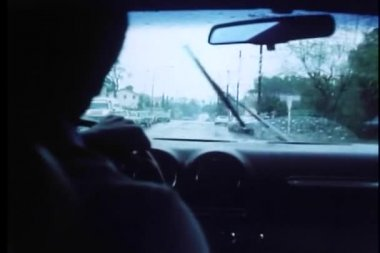 Interior view of man driving car in the rain — Stock Video