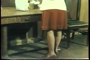 Rear view of lower half of woman wearing 1970s platform heels — Stock Video