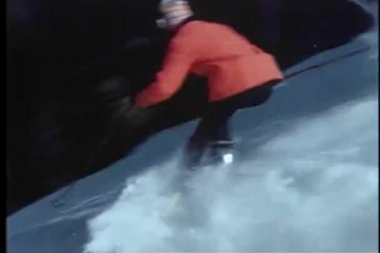 Two skiers skiing down Colorado slopes — Stock Video