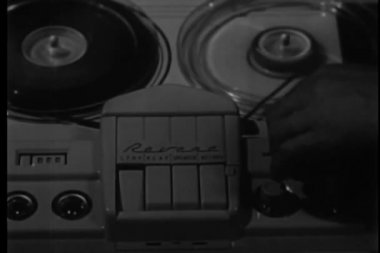 Close-up of man's hand switching on tape recorder — Stock Video #26644991