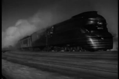 Steam train in motion on tracks — Stock Video