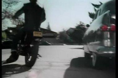 Rear view of man riding motor bike down street — Stock Video