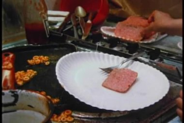 Medium shot of girl pouring ketchup on slices of Spam — Stock Video