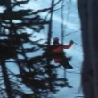 Rear view of ski patrol skiing on slope — Stock Video