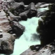 High angle view of water flowing through rocks in river — Stock Video