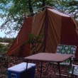 Stock Video: Campsite set up near lake