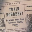 Stock Video: Montage of newspaper headlines of train robberies