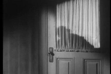 Shadow of mysterious man opening door — Stock Video