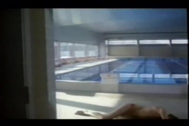 Terrorists holding hostage in indoor pool — Stock Video