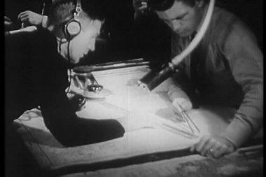 Navy crew taking measurement on map — Stock Video