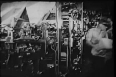 Montage of men working in printing factory — Stock Video