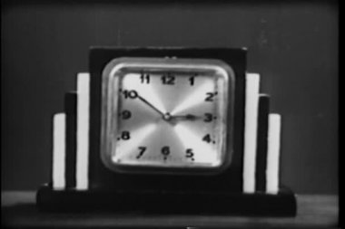 Close-up of art deco clock showing time transition — Stock Video