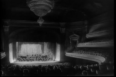 Wide angle view of orchestra performing in theater — Stock Video
