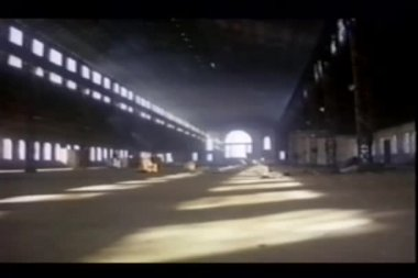 Tracking shot of abandoned airplane hangar — Stock Video