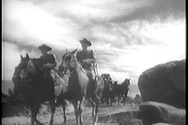 Wide shot of soldiers leading wagon train