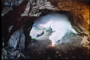 Men setting off dynamite in cave — Stock Video