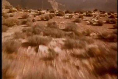 Steadicam shot off side of cliff — Stock Video