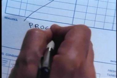 Close-up of man writing food and progress report in journal — Stock Video