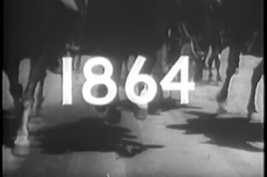 Years1864-1865 superimposed over low angle view of galloping horses — Stock Video
