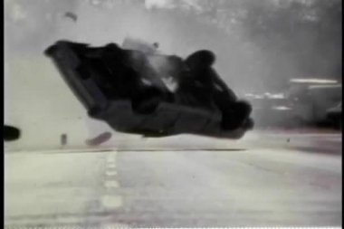 Stunt car turning over and over in slow motion — Stock Video