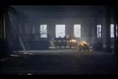 Zoom out bikers leaving abandoned building — Vídeo de stock