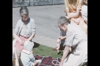 Grandmother playing with baby on blanket — Wideo stockowe