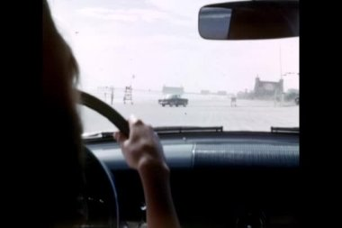 Point of view shot of woman driving along the beach — Stock Video