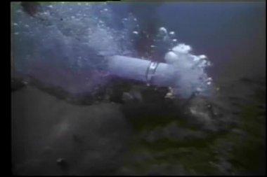 Bomb exploding underwater near scuba diver — Stock video
